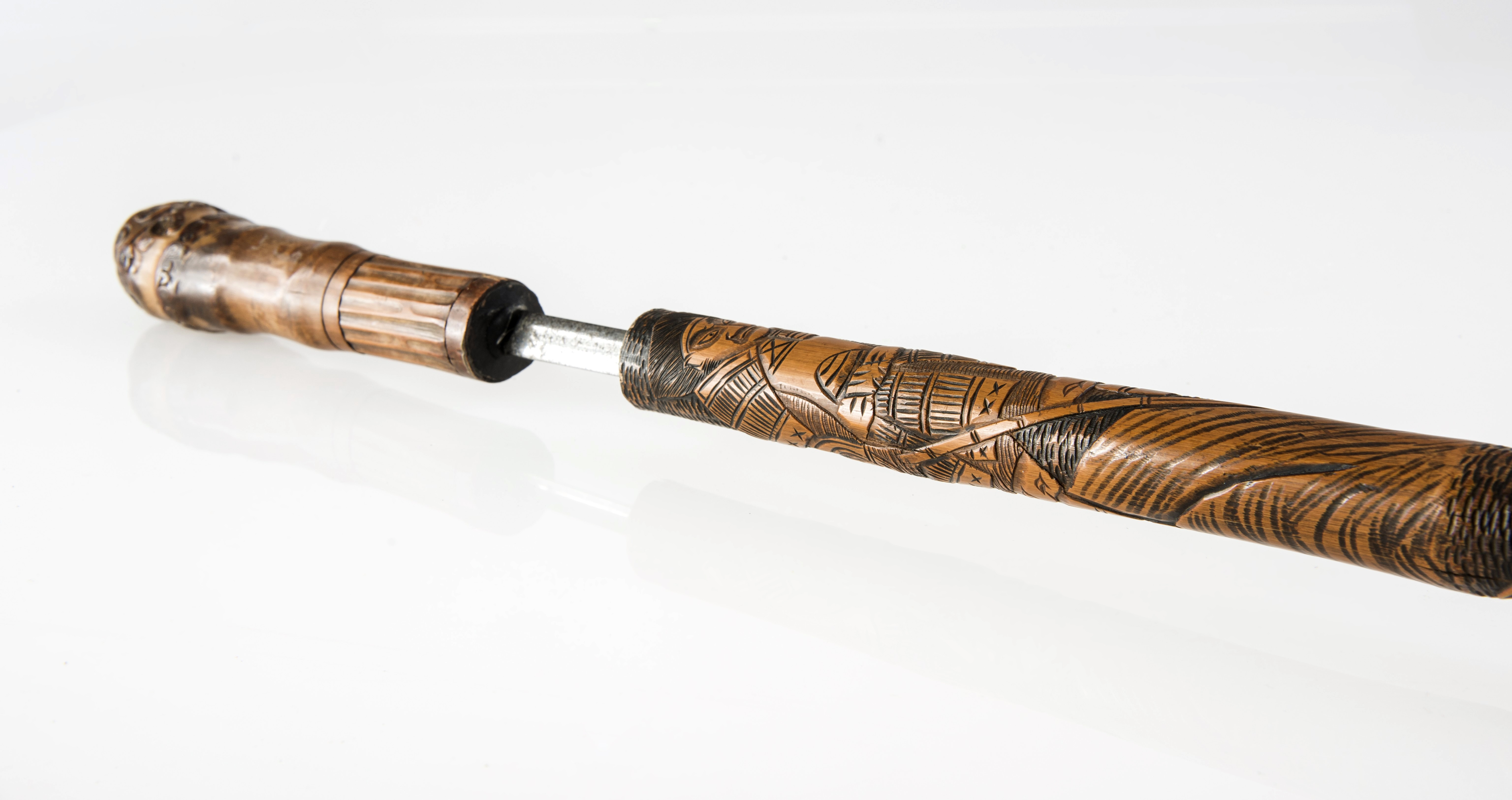 A japanese carved bamboo sword stick probably meiji