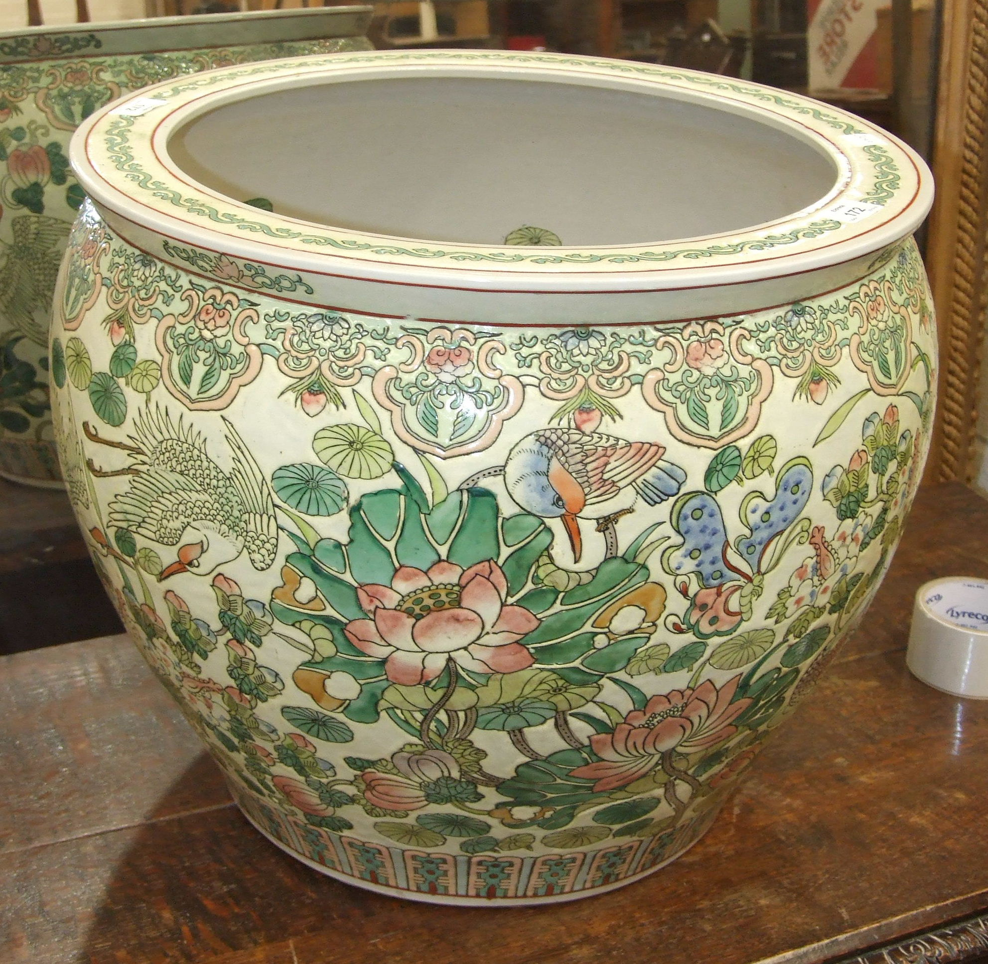 Lot 172 - A large reproduction Chinese fish tank, the outside decorated with flowers and birds in pale