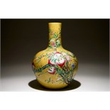 A Chinese famille rose tianqiuping bottle vase with 9 peaches design on a dark yellow ground, 19/