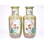 A pair of large Chinese yellow ground famille rose vases, 19/20th C. H.: 79 cm Condition reports and
