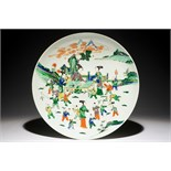 A very large Chinese famille verte dish with ladies and playing boys in a garden, 19th C. Dia.: 46,5