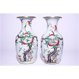 """A pair of Chinese famille rose """"nine peaches"""" vases, 19th C. H.: 43 cm Condition reports and high"""