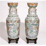 A pair of very large Chinese Canton rose-verte vases with lotus-shaped mouths, 19th C. H.: 101,5