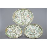 Three large Chinese Canton famille verte dishes, 19th C. Dim.: 46,5 x 37,5 x 5 cm (largest)