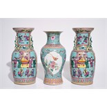 A pair of Chinese famille rose on turquoise ground vases, 19th C., and a vase with Qianlong mark,