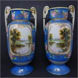 A pair of Japanese Noritake hand painted porcelain vases, H.33cm