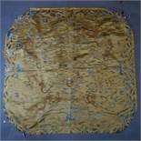 A late 19th/early 20th century Chinese silk panel, decorated with dragons amongst stylised waves,