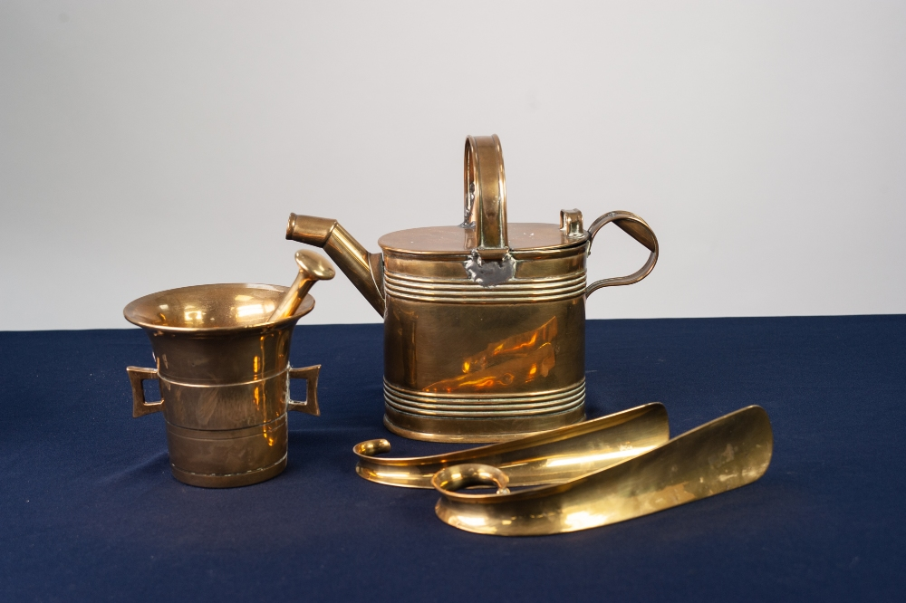 Lot 81 - NINETEENTH CENTURY BRASS TOILET WATER CAN, oval with flat hinged lid; A HEAVY BASS PESTLE AND MORTAR
