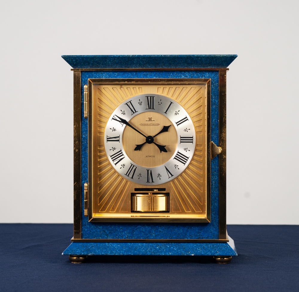 Lot 37 - UNUSUAL GILDED BRASS AND LAPIS LAZULI CASED JAEGER LE-COULTRE ATMOS CLOCK with silvered Roman