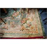 LARGE HEAVILY QUALITY WASHED CHINESE CARPET, of Aubusson design with large oval cream and floral