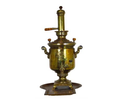 This is a rare barrel-shaped brass samovar with an Imperial Russian double-headed eagle engraving. It was produced in Tula in
