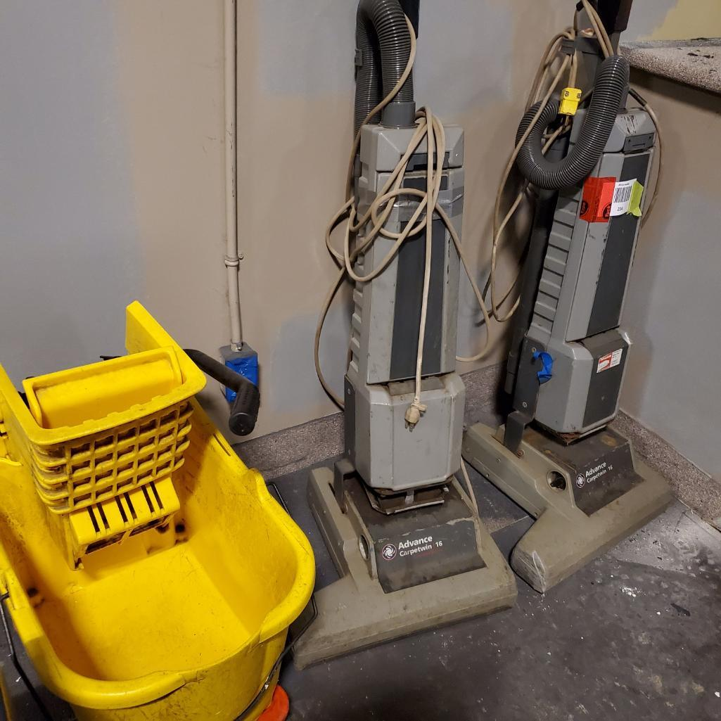 Lot 214 - Vacuums and Mop Bucket, Rough. Used, shows commercial use. See pictures.