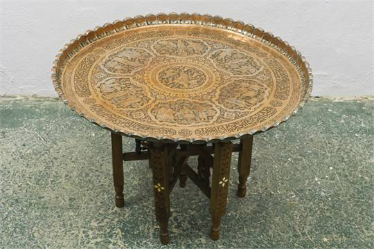 A Circular Persian Copper Traytable Decorated With Scenes
