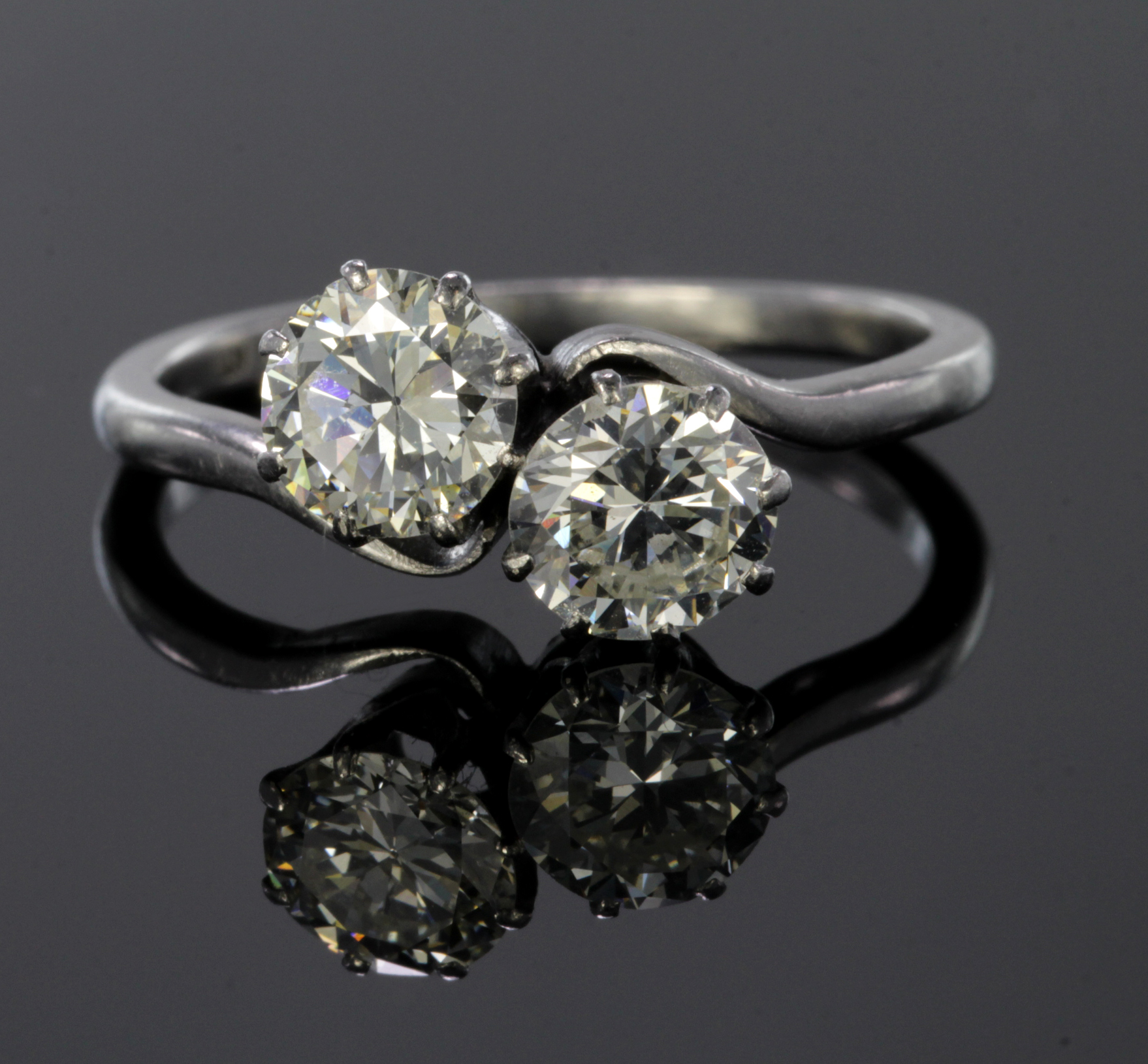 Lot 34 - Platinum ring set with two diamonds, each calculated to weigh approx. 0.75ct. Finger size M,