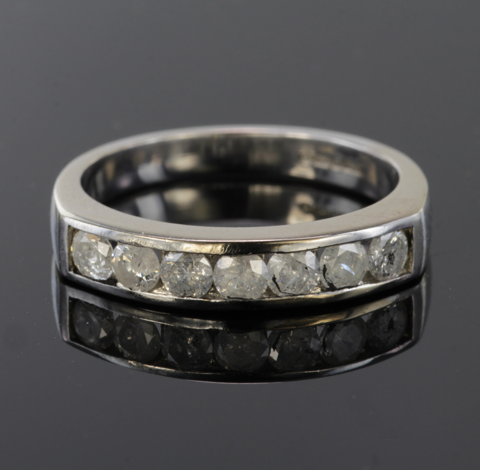 Lot 29 - 18ct White Gold seven stone channel set Diamond Ring size N weight 5.0g