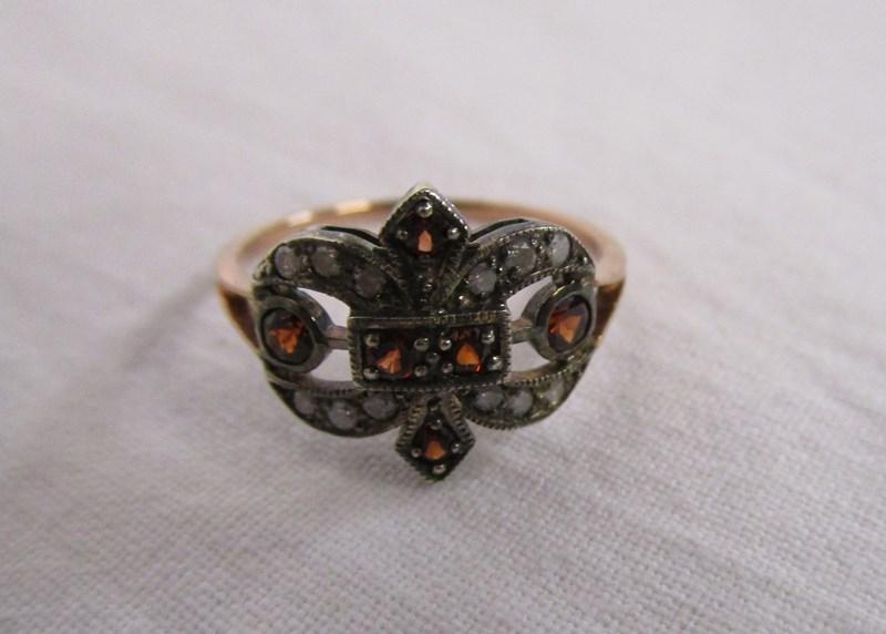 Lot 13 - Gold diamond & garnet set ring