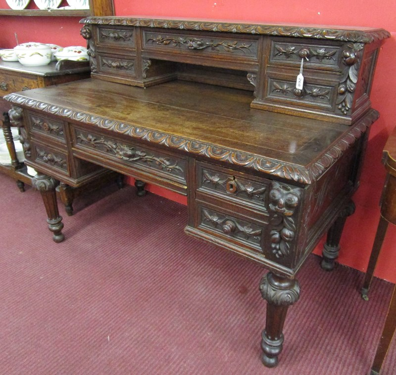 Lot 268 - Antique carved oak desk