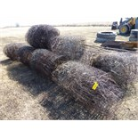 Several rolls of used woven wire