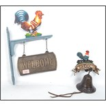 Lot 1065 - Two vintage 20th century cast iron welcome signs with cockerels atop, one having a bell and the