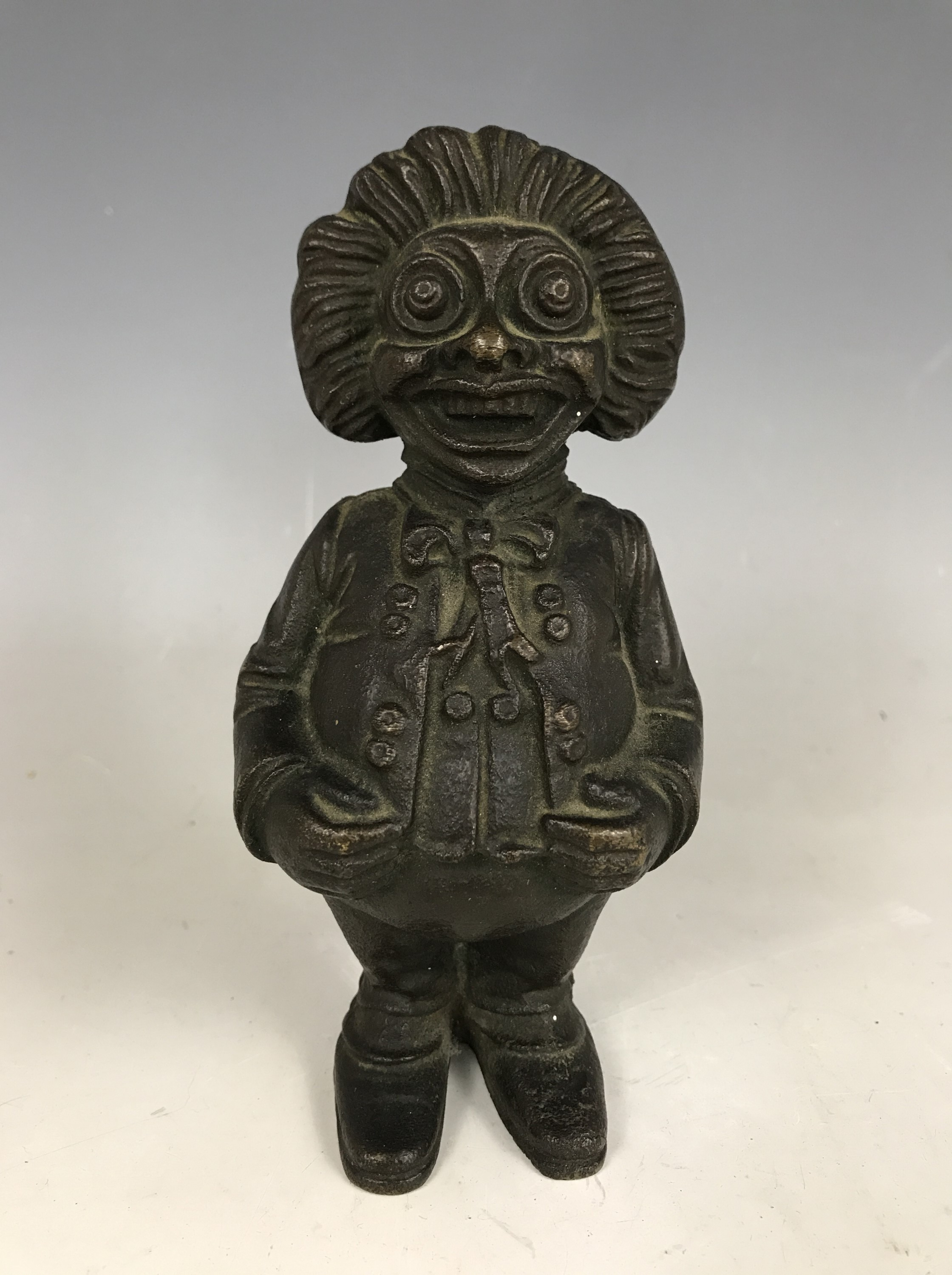Lot 46A - A novelty patinated brass money box / bank modelled as a standing figure