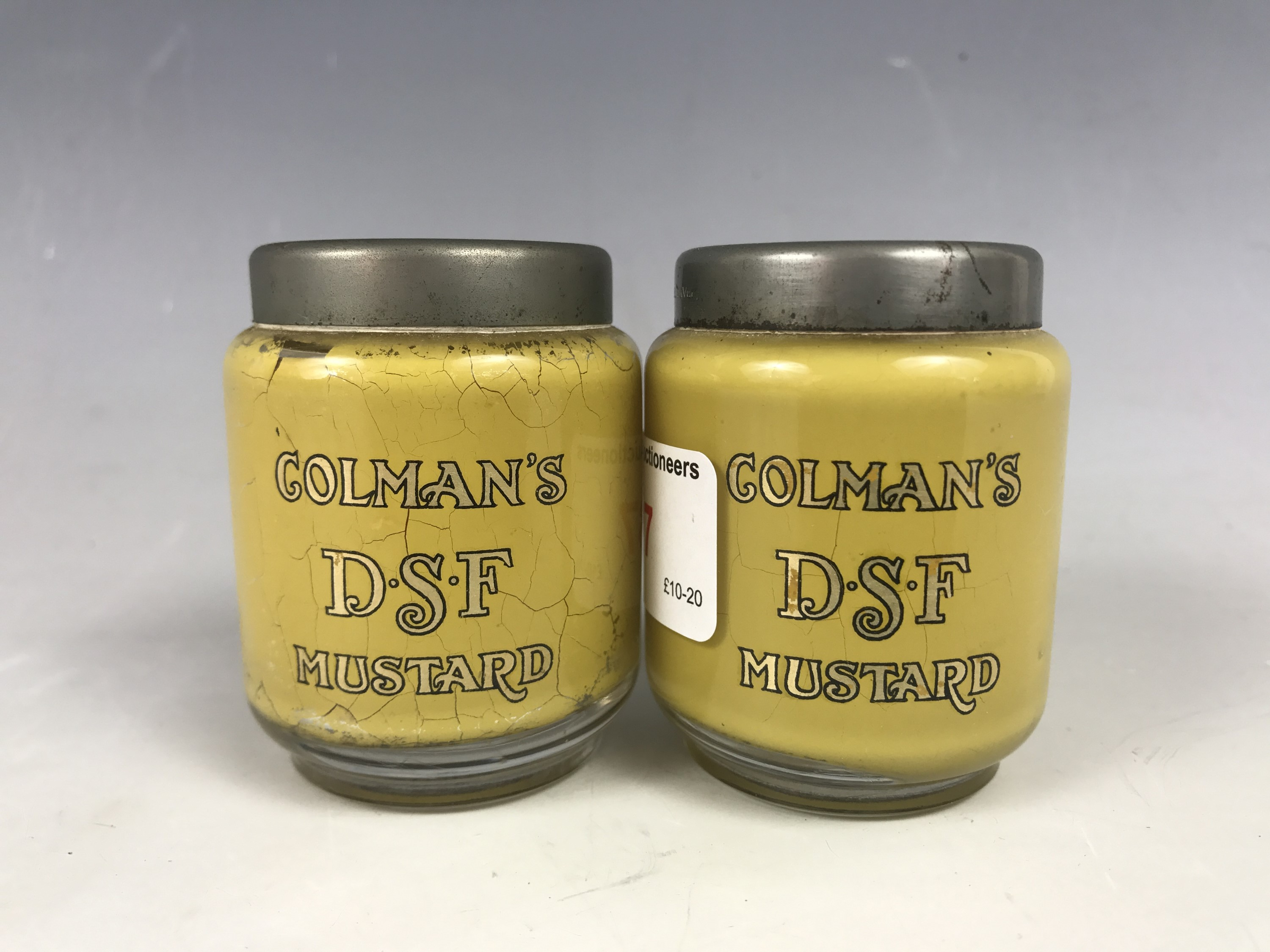 Lot 37 - A pair of late 19th century D.G. Ware Colmans DSF Mustard glass cruets