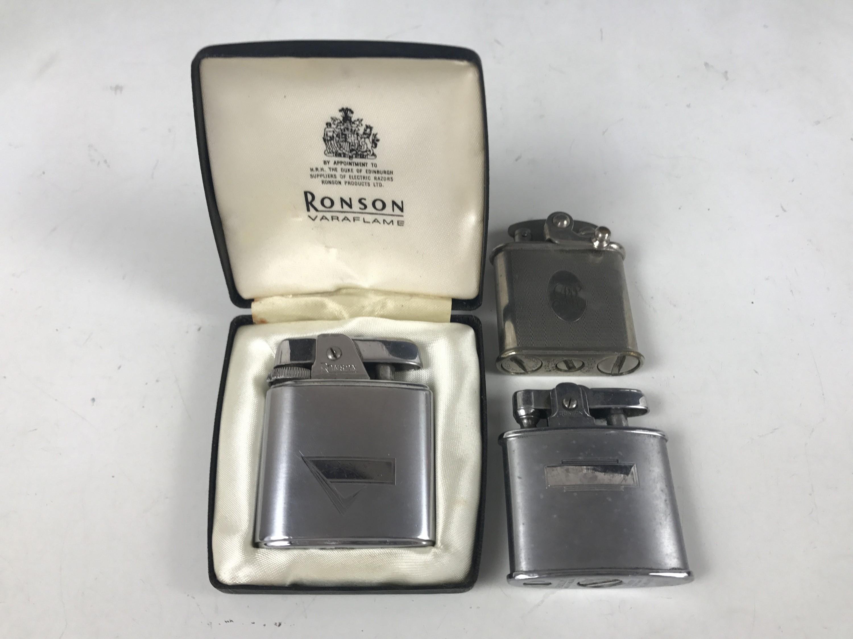 Lot 55 - Three various Colibri and Ronson cigarette lighters, circa 1930s-1950s