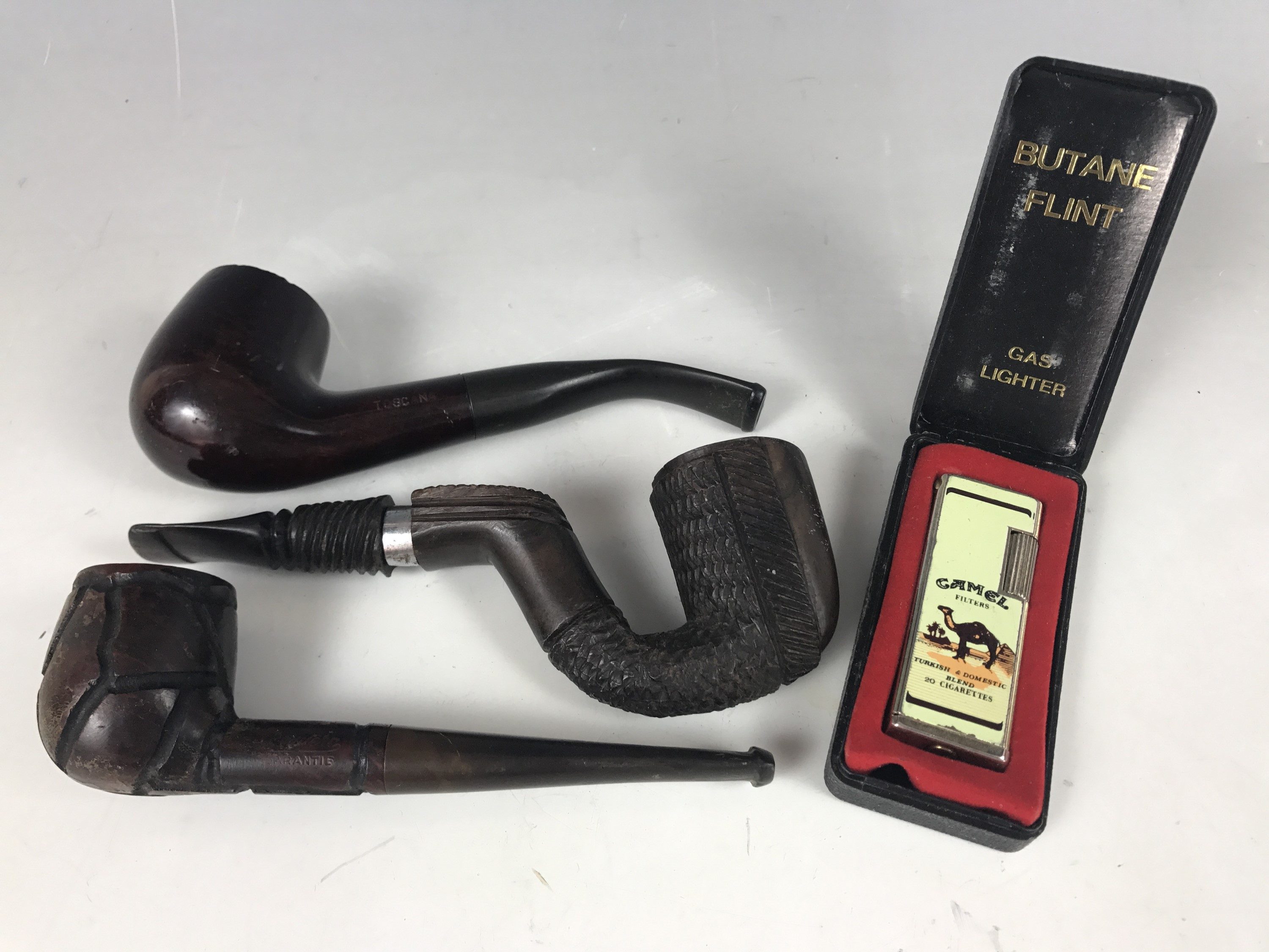 Lot 43 - A vintage briar wood pipe together with two other pipes and a cased Camel Filters lighter