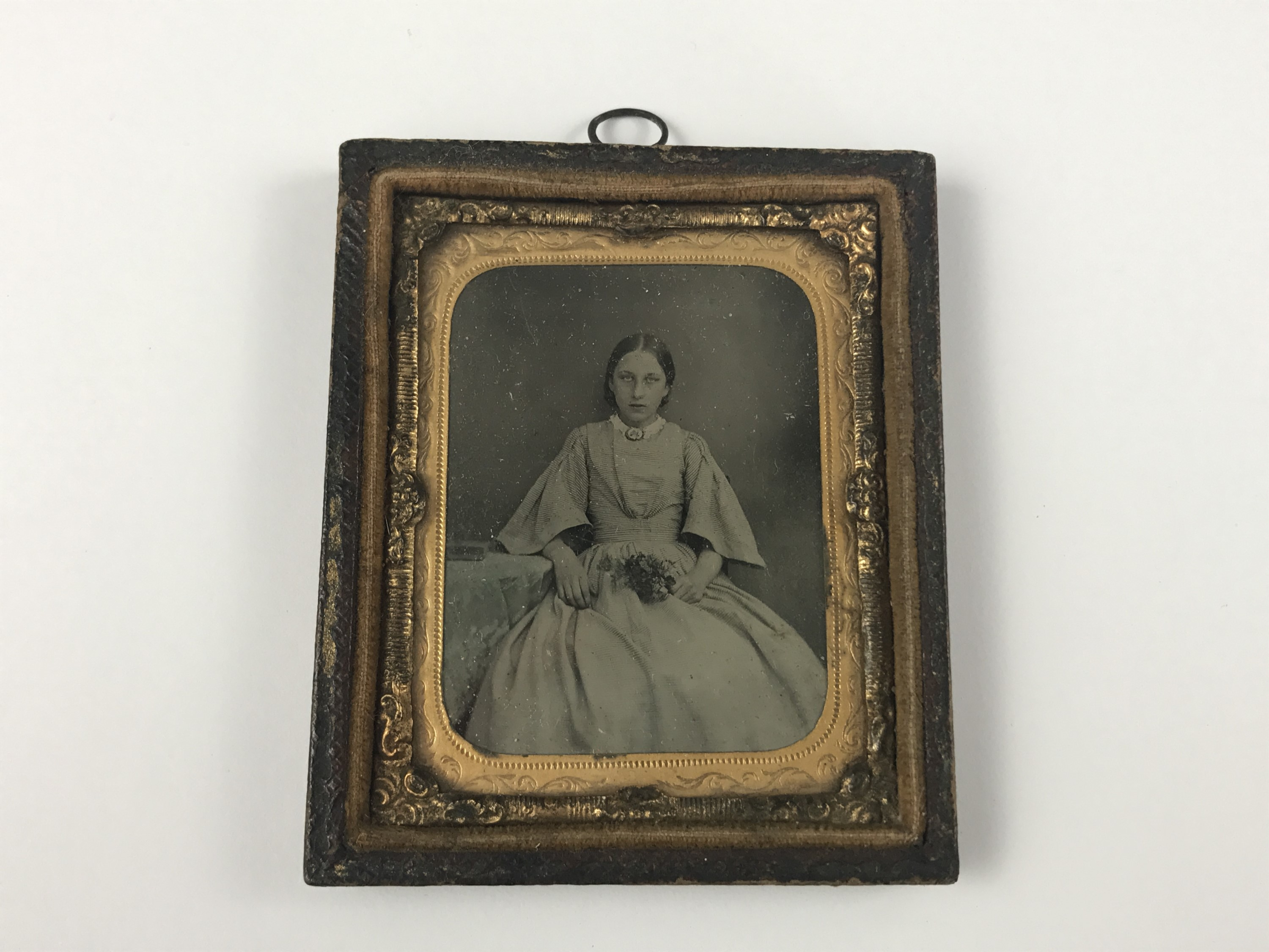Lot 4 - A Victorian tintype of a young lady, circa 1850