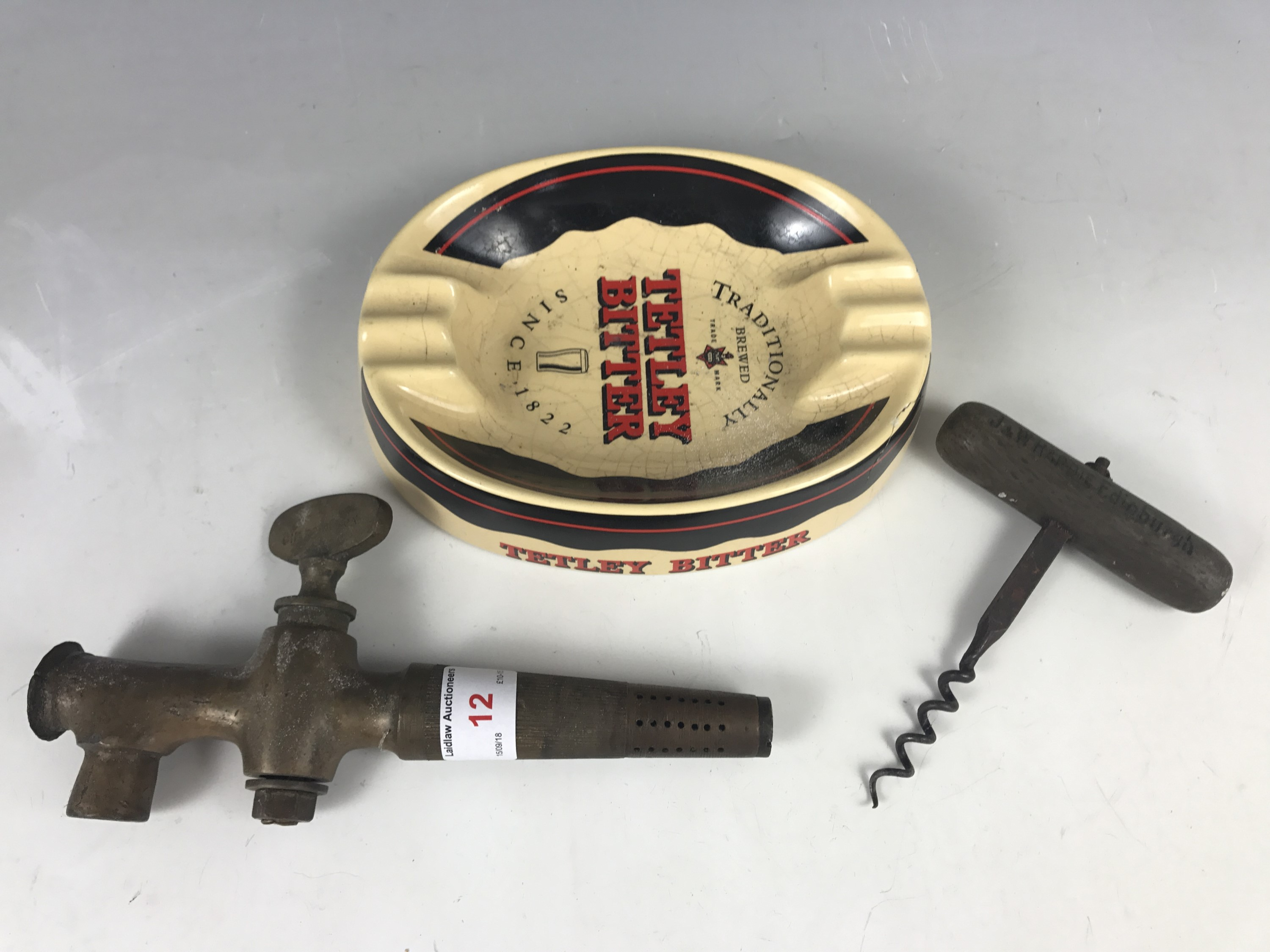 Lot 12 - Vintage breweriana including a Tetley Bitter ashtray, a Charrington barrel tap and a J & W Hardie