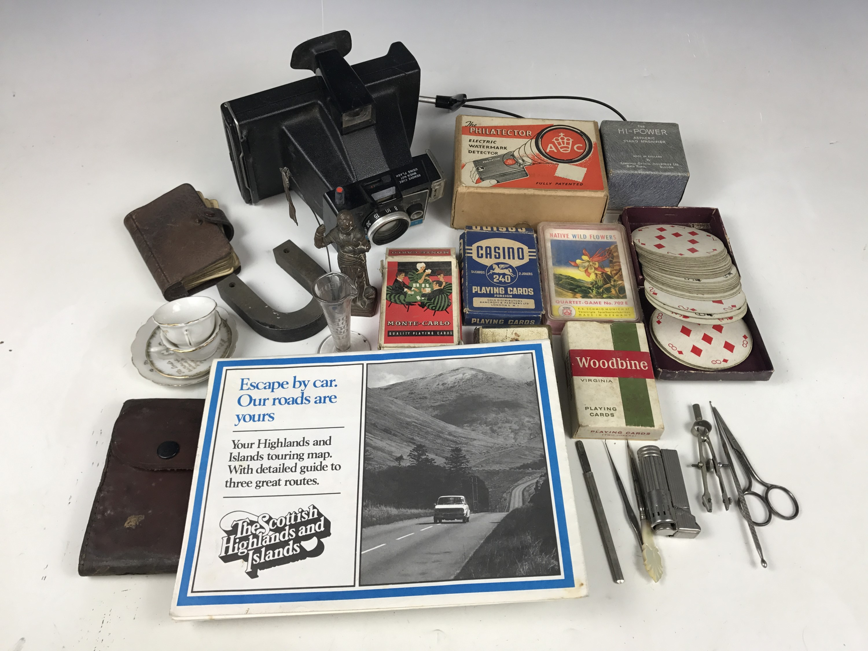 Lot 9 - Sundry collectors' items including a Polaroid Colorpack II land camera, maps, playing cards, a cased