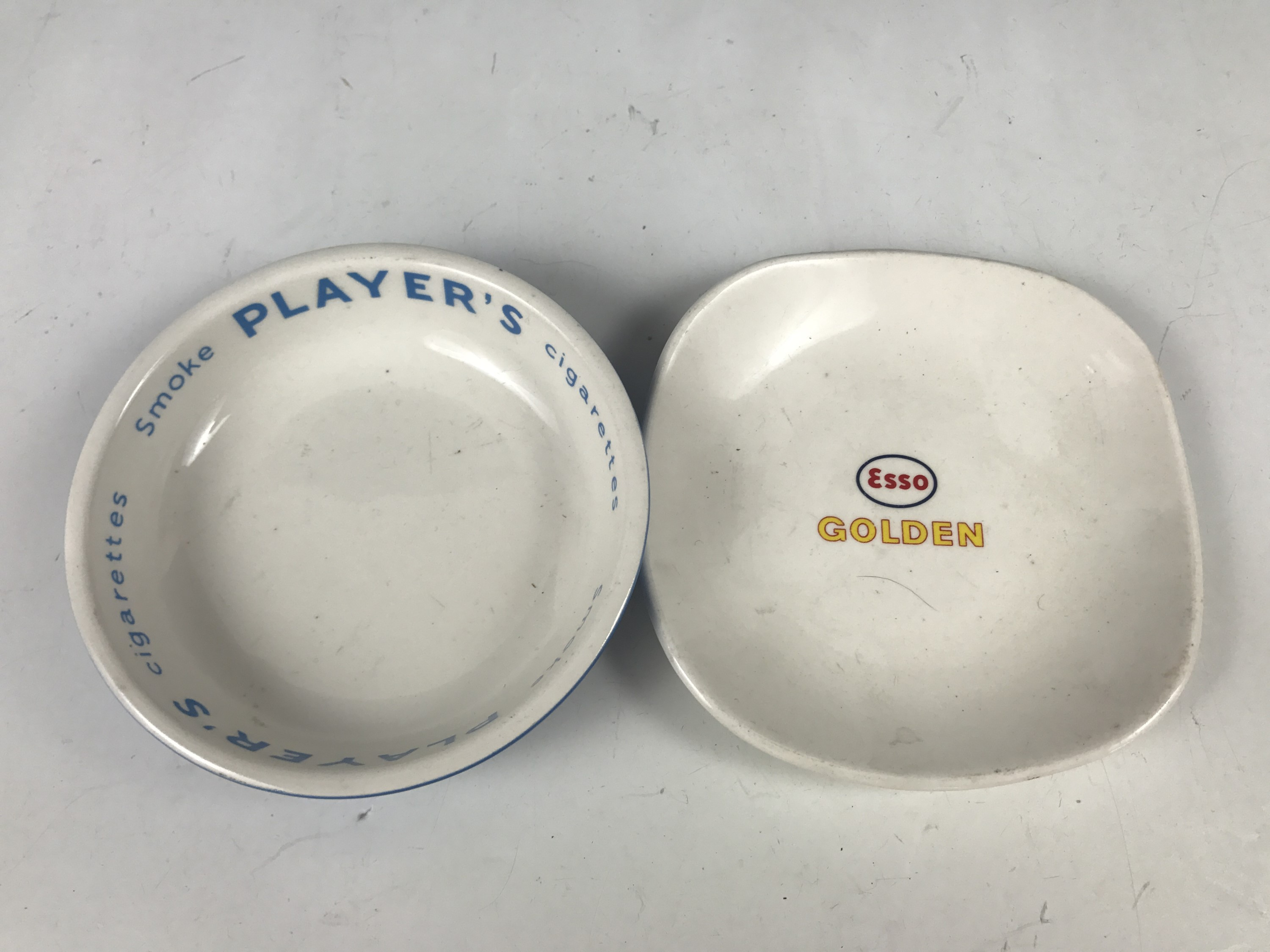 Lot 35 - A Players advertising dish together with an Esso golden dish