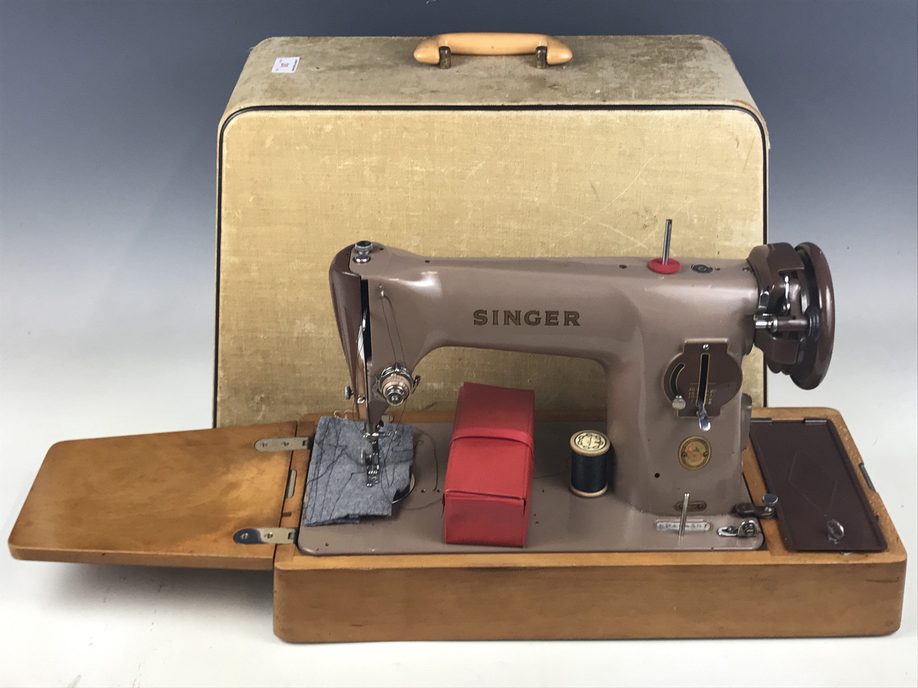 Lot 20 - A cased Singer sewing machine, model EP486307