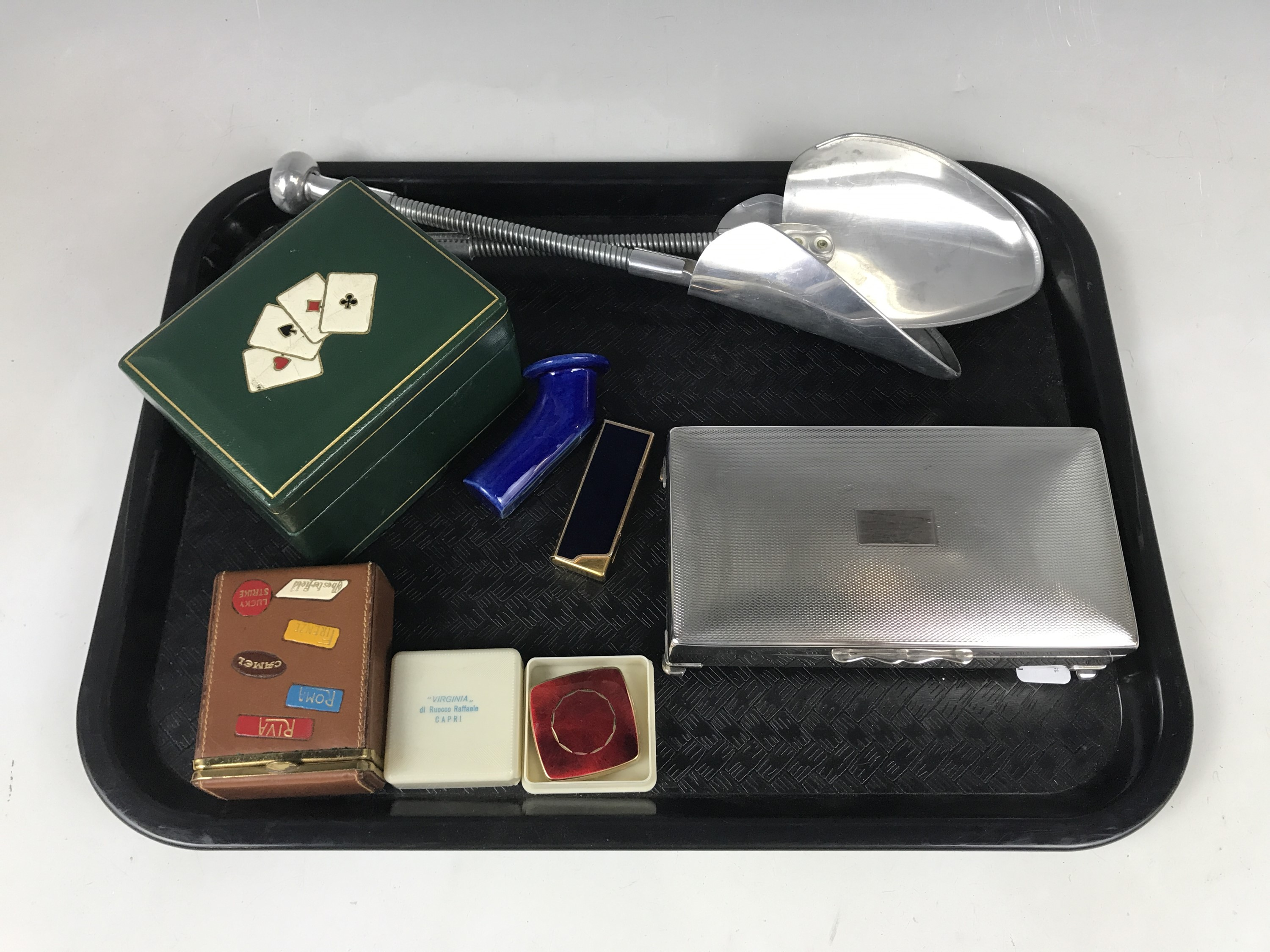 Lot 50 - An electroplate cigarette box together with a boxed pocket ashtray, a cigarette lighter and a tooled