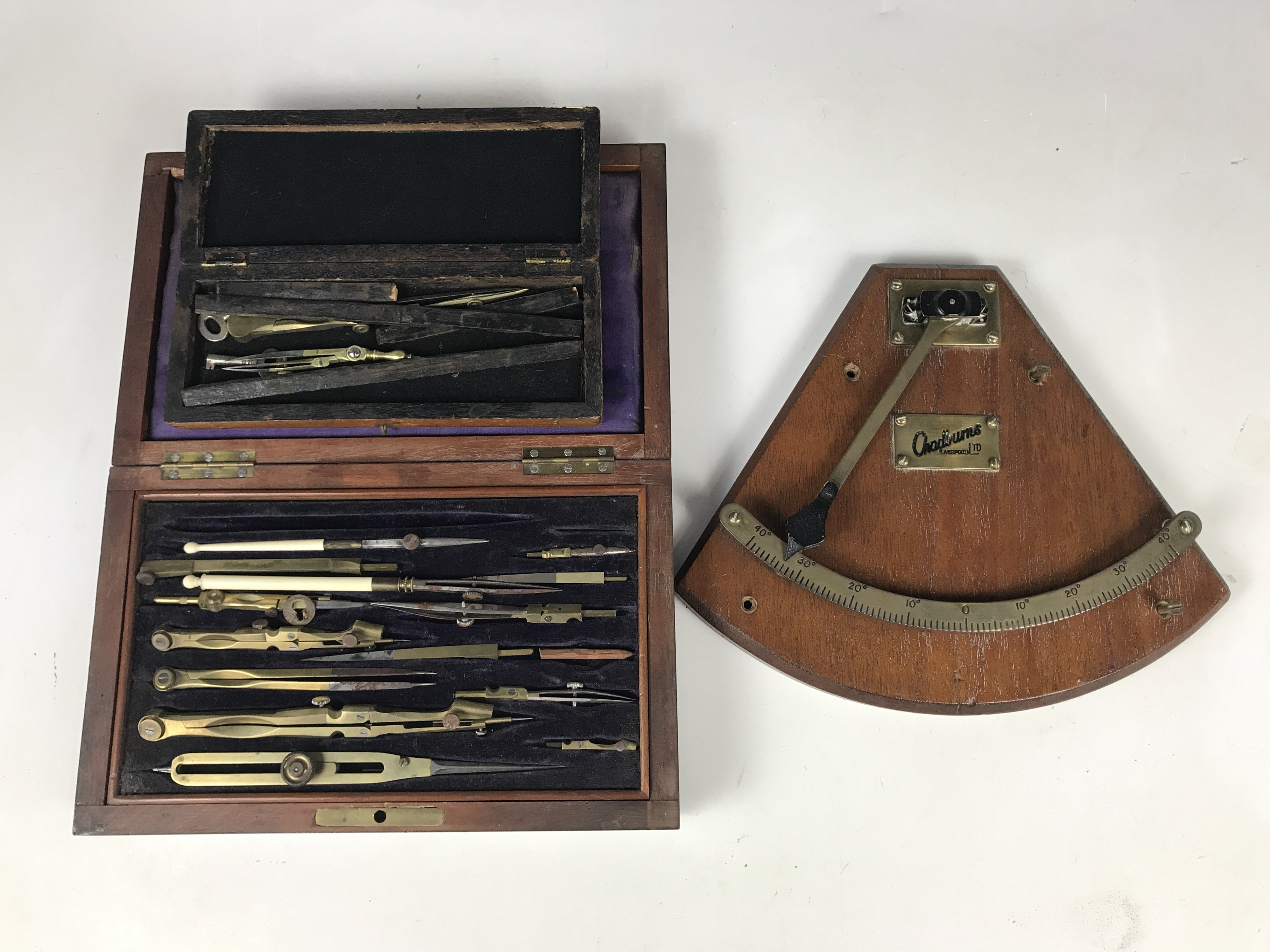 Lot 24 - A Victorian mahogany cased drawing instrument set, together with one other smaller example, and a