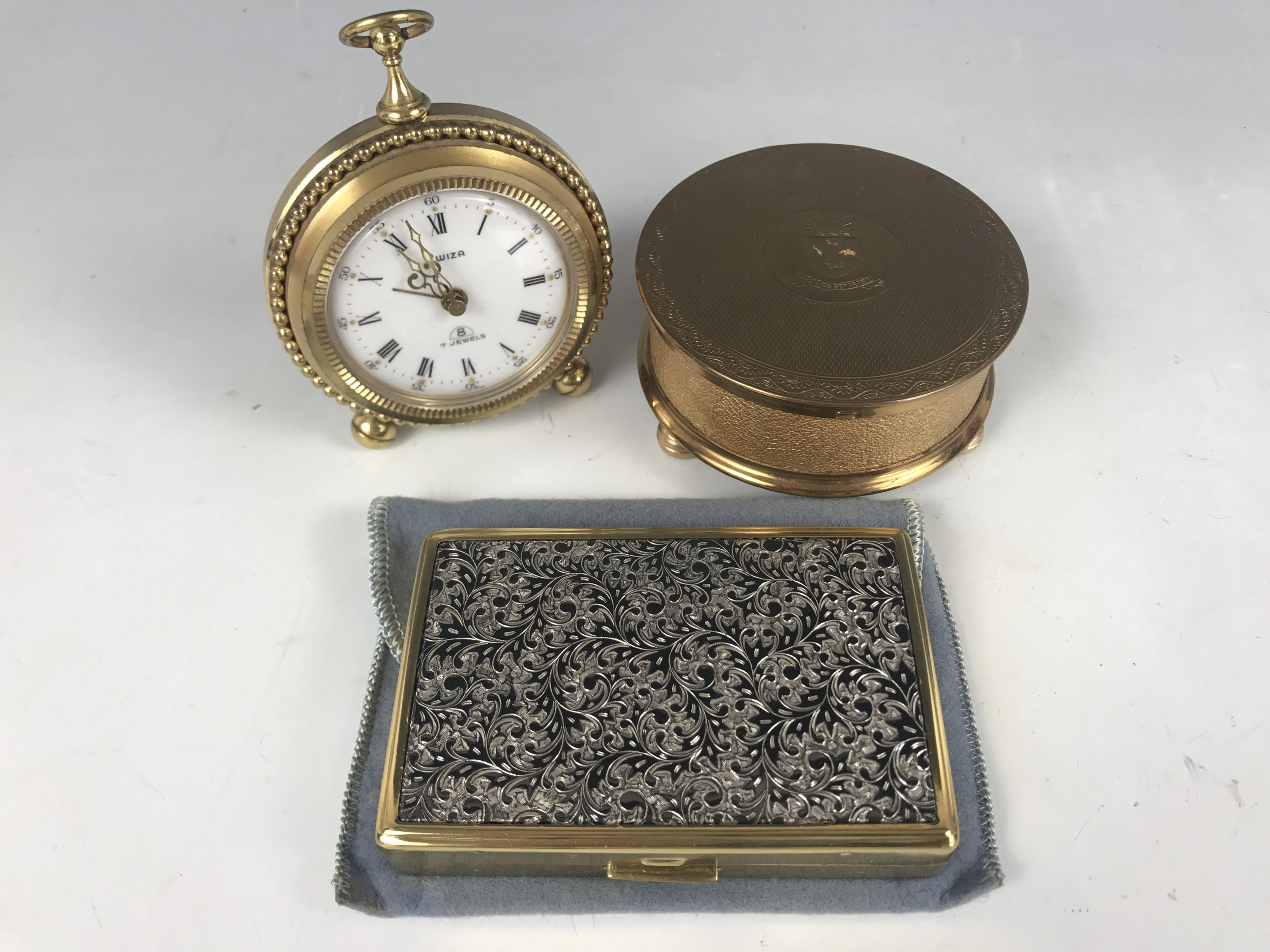 Lot 45 - A novelty Swiza alarm clock together with a Sonata musical compact and one other compact