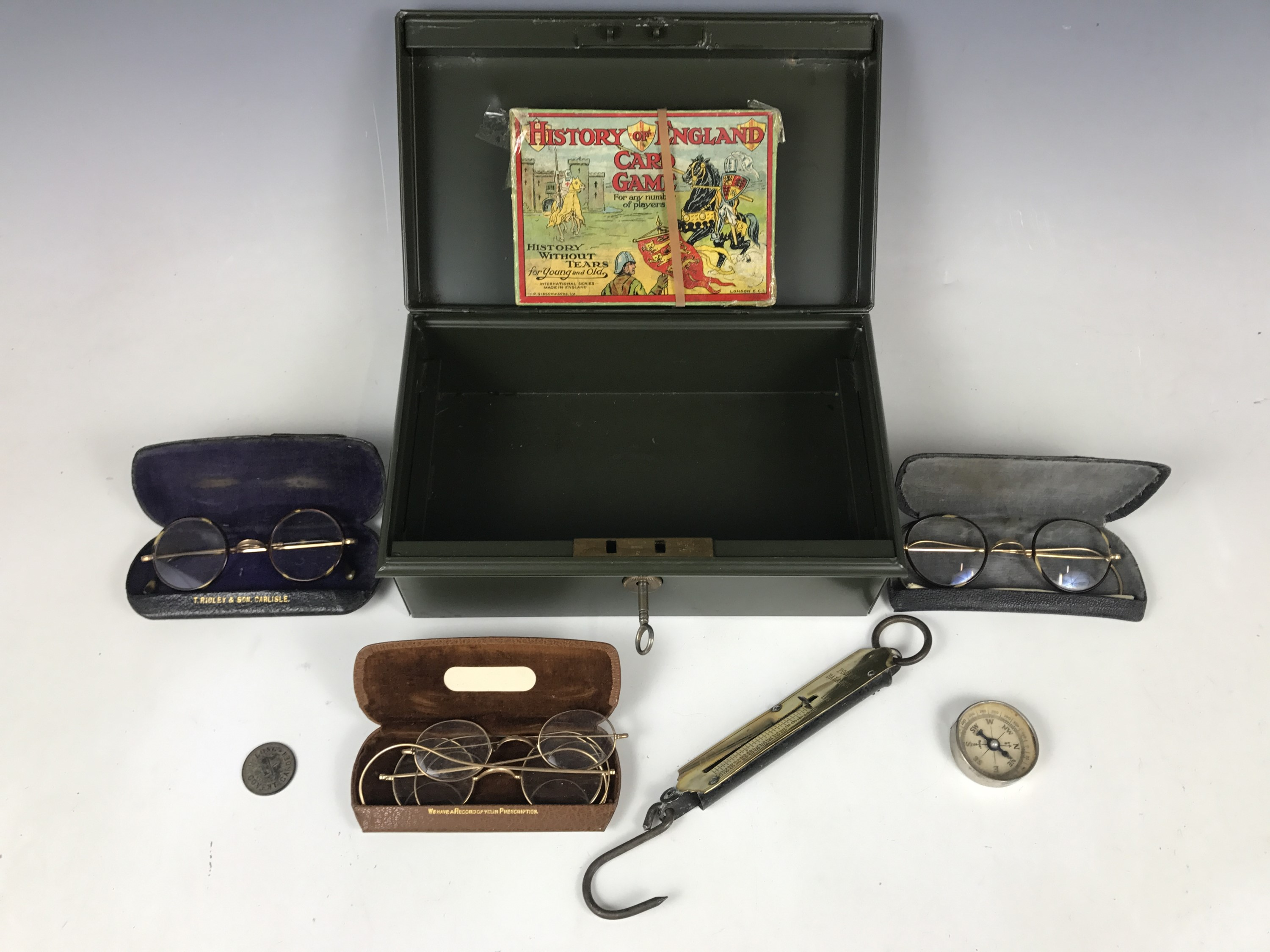 Lot 46 - A metal cash box together with pince-nez, spectacles, a pocket balance and a vintage game