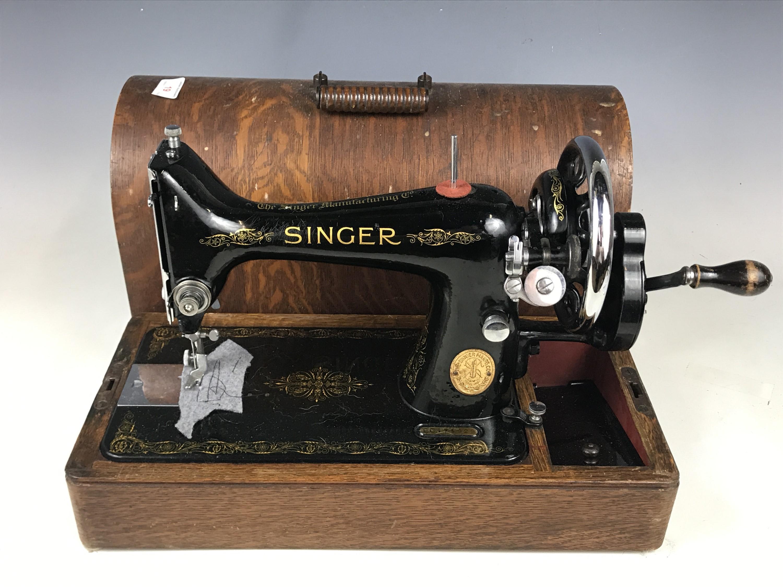 Lot 19 - A cased Singer sewing machine, model EC174929