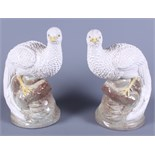 """A pair of glazed pottery birds of paradise, 10 1/2"""" high"""