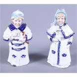 """A pair of early 20th century German porcelain nodding dolls, 6 1/2"""" high"""
