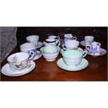"""A collection of various English porcelain coffee cans and saucers, including Royal Worcester """"Blue"""