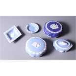 Five pieces of mid 20th century Wedgwood jasperware, including three trinket boxes and two pin
