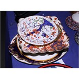 """A 19th century Derby """"Tree"""" pattern oval meat plate and side plate, a Wedgwood plate decorated"""