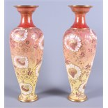 A pair of Doulton & Slaters Patent stoneware vases, in yellow and orange colouring with gilt painted