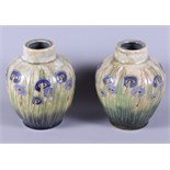 """A pair of Royal Doulton stoneware vases, decorated with flowers in the Secessionist style, 8"""" high"""