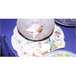An English Delft? pottery charger, brightly decorated with sprays of flowers within a scalloped