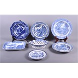 An early 19th century blue and white transfer decorated chestnut basket, a similar osier plate, four