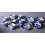 A group of early 19th century English blue and white coffee cans and saucers, various, including