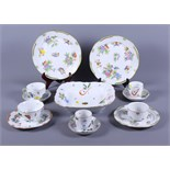 Twelve pieces of Herend hand-painted porcelain, including plates, bowls, etc
