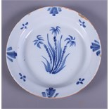 """A Dutch 18th century tin glazed Delftware plate, painted with sprays of flowers, 9"""" dia"""