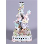 A late 19th century Meissen porcelain figure candlestick, modelled in the form of two children